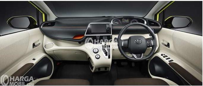 Bagian interior mobil Toyota Sienta 2016 berwarna utama yaitu coklat muda