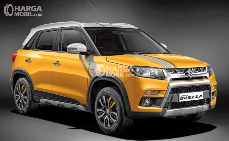Gambar mobil Suzuki Vitara Brezza 2018 berwarna kuning dilihat dari sisi depan