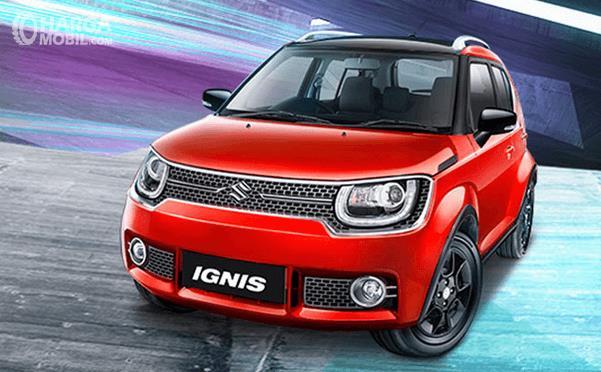 Gambar ini menunjukkan Suzuki Ignis warna merah tampak bagian depannya