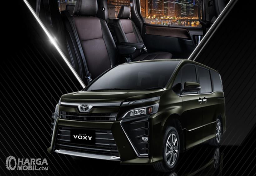 Gambar ini menunjukkan Toyota Voxy warna hitam dan diatasnya ada gambar kursi