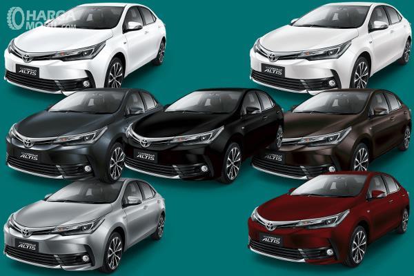 Gambar ini menunjukkan 7 mobil Toyota Corolla Altis dengan warna berbeda