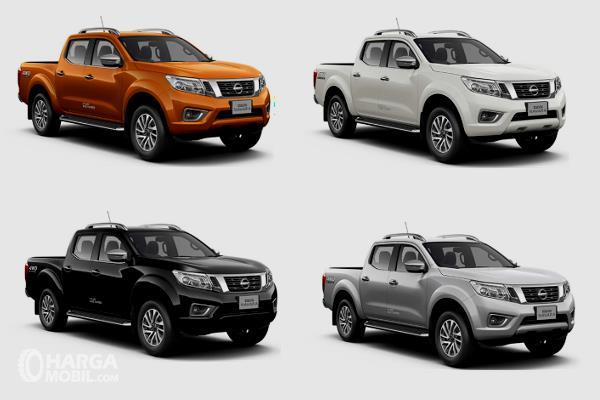 Gambar ini menunjukkan 4 buah mobil  Nissan Navara dengan warna yang berbeda