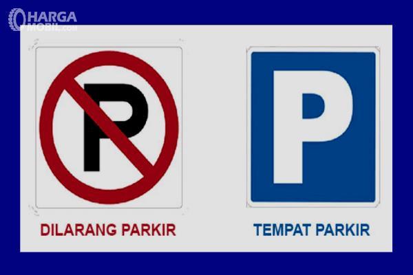 Gambar ini menunjukkan rambu dilarang parkir dan tempat parkir