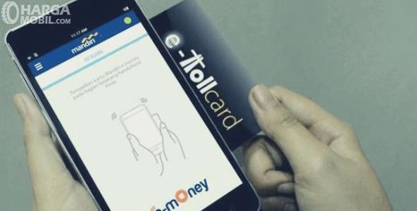 Gambar ini menunjukkan onsel dan kartu E-Toll