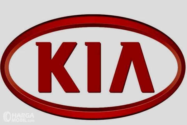 Gambar ini menunjukkan logo KIA dengan warna merah