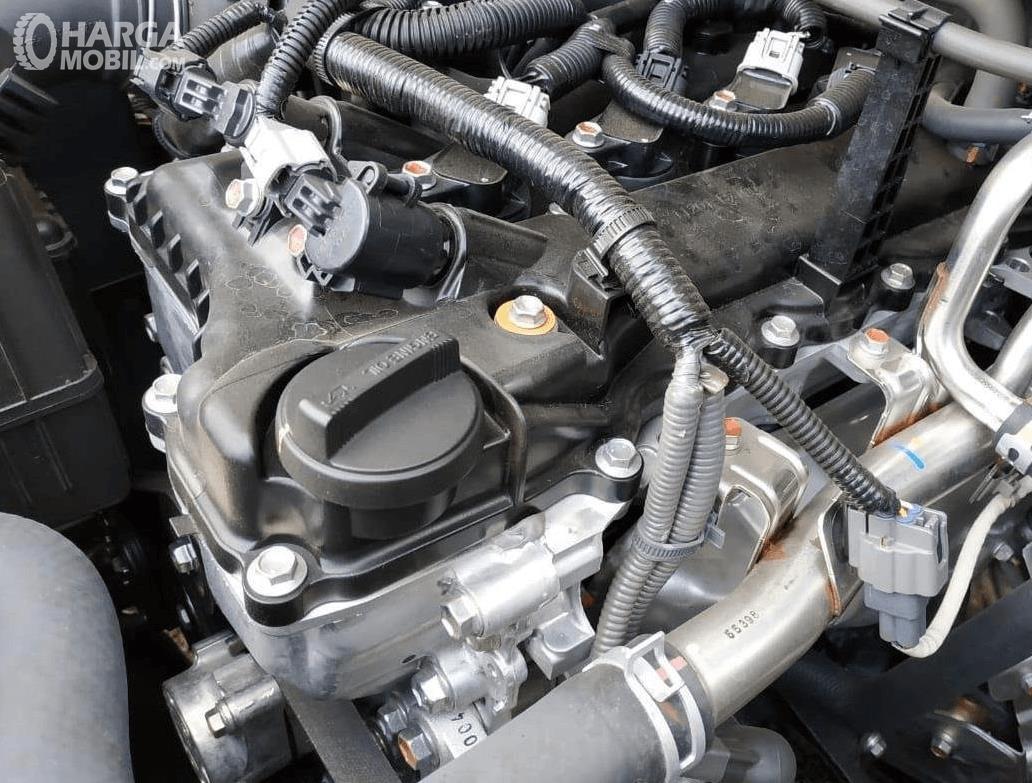Gambar ini menunjukkan mesin mobil Toyota Avanza 1.5 G