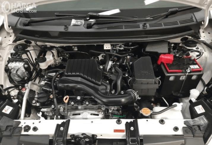 Gambar ini menunjukkan mesin Daihatsu Sirion 2020