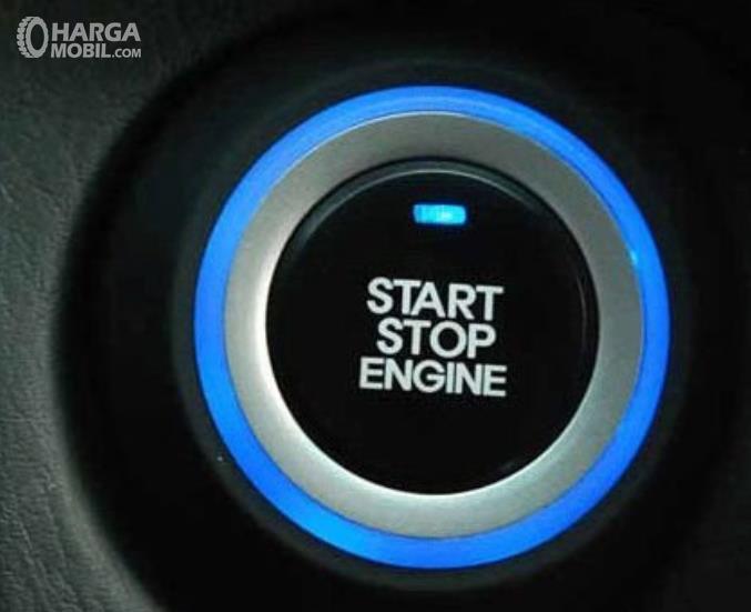 Gambar ini menunjukkan tombol untuk menyalakan dan mematikan mesin mobil