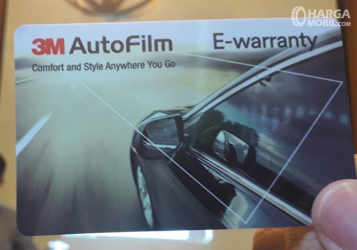 Gambar ini menunjukkan kartu garansi dari Autofilm