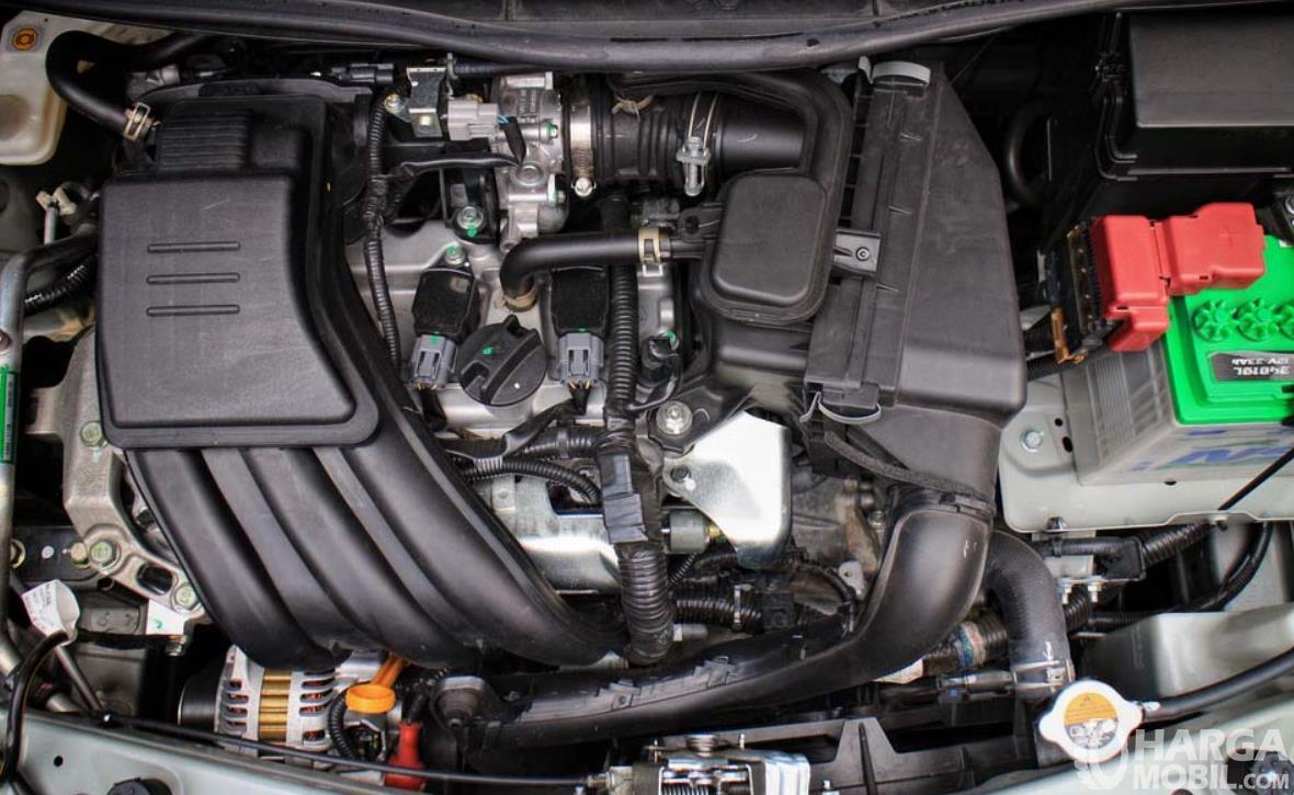 Gambar ini menunjukkan mesin mobil dengan 3 silinder