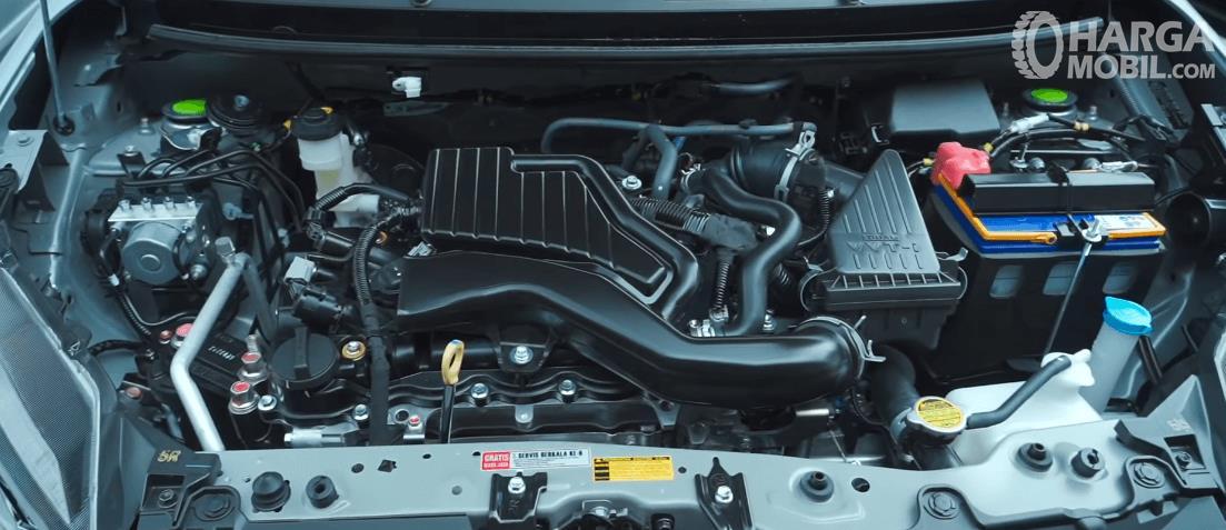 Gambar ini menunjukkan mesin mobil Toyota Agya 1.2 G AT TRD Facelift 2020