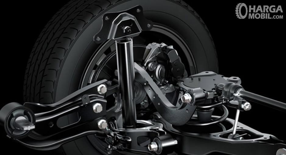 Gambar ini menunjukkan roda dan suspensi mobil