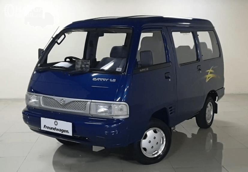 Gambar ini menunjukkan bagian depan mobil Suzuki Carry Futura 1.6 GRV 1999